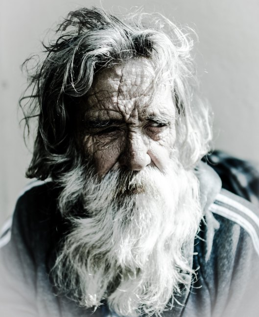 Attractive older man with grey hair and beard.