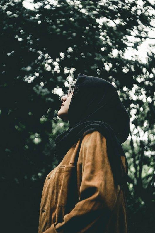 Muslim woman looking thoughtful.