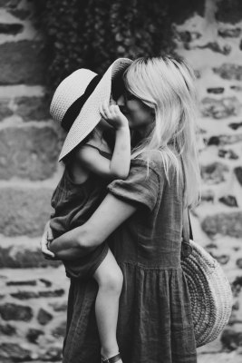 Black and white photo of mother and child hugging.