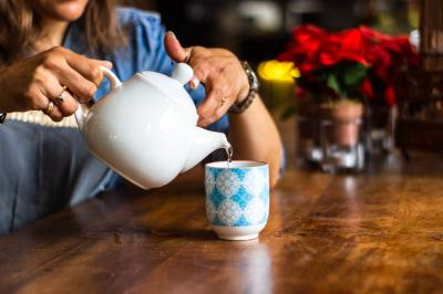 Woman pouring a cup of tea
