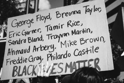Demonstration board listing the names of black lives recently lost to police brutality in the US.