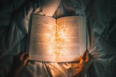 Open book, lit up with fairy lights.