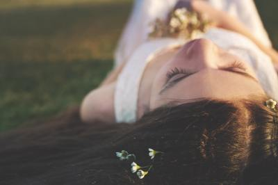 Girl lying down on the grass relaxing.